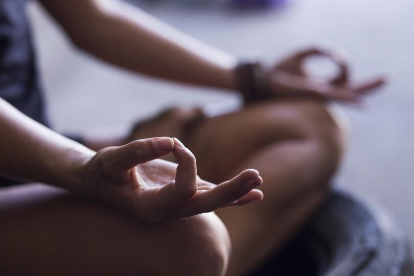 bigstock-Young-woman-meditating-indoors-90332759-810x540