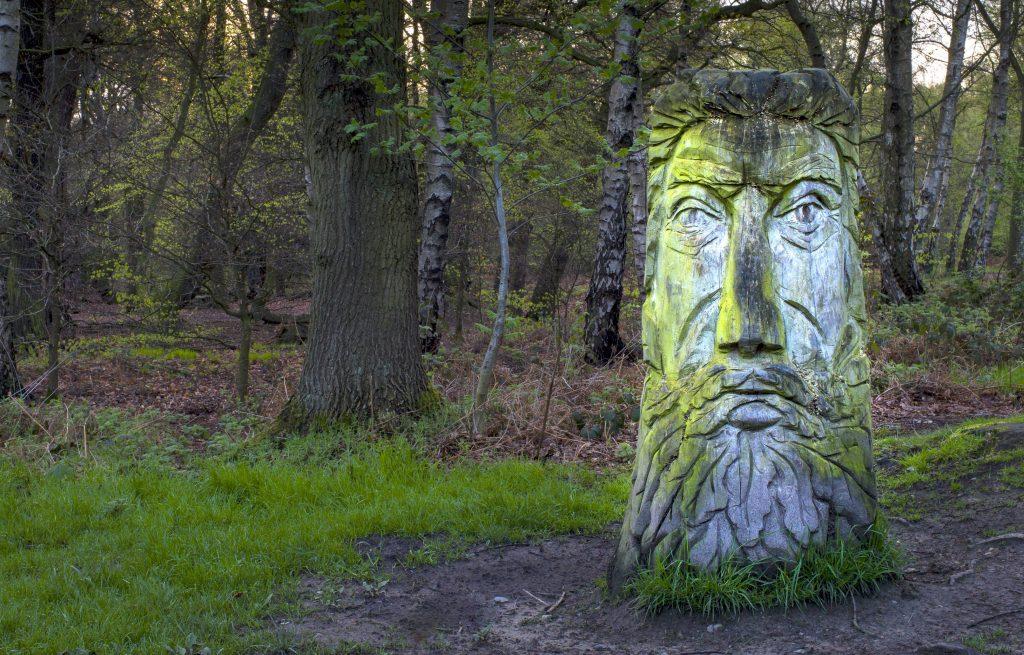 a-green-man-carved-from-a-tree-trunk-522184542-5837acb05f9b58d5b1cb6cc7